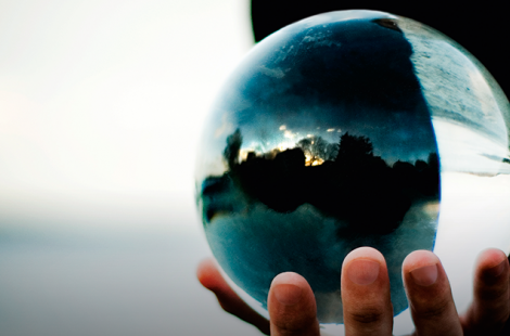 This is a photo of a man holding a crystal ball.