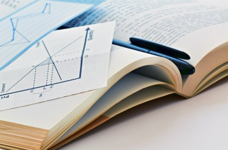 Image for CFRA Teaching and Research Page: Open book with graphs